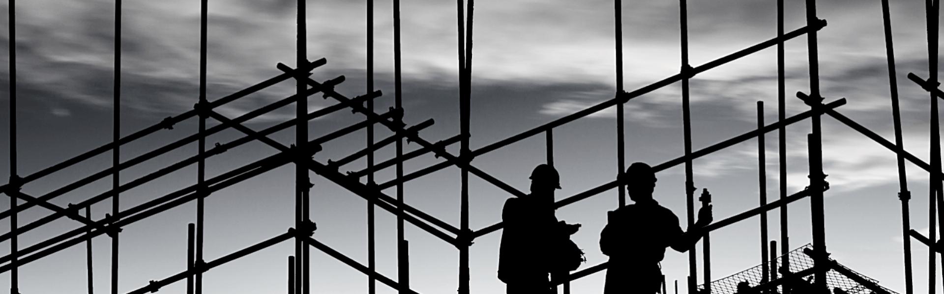 Mannen op de bouwloading=