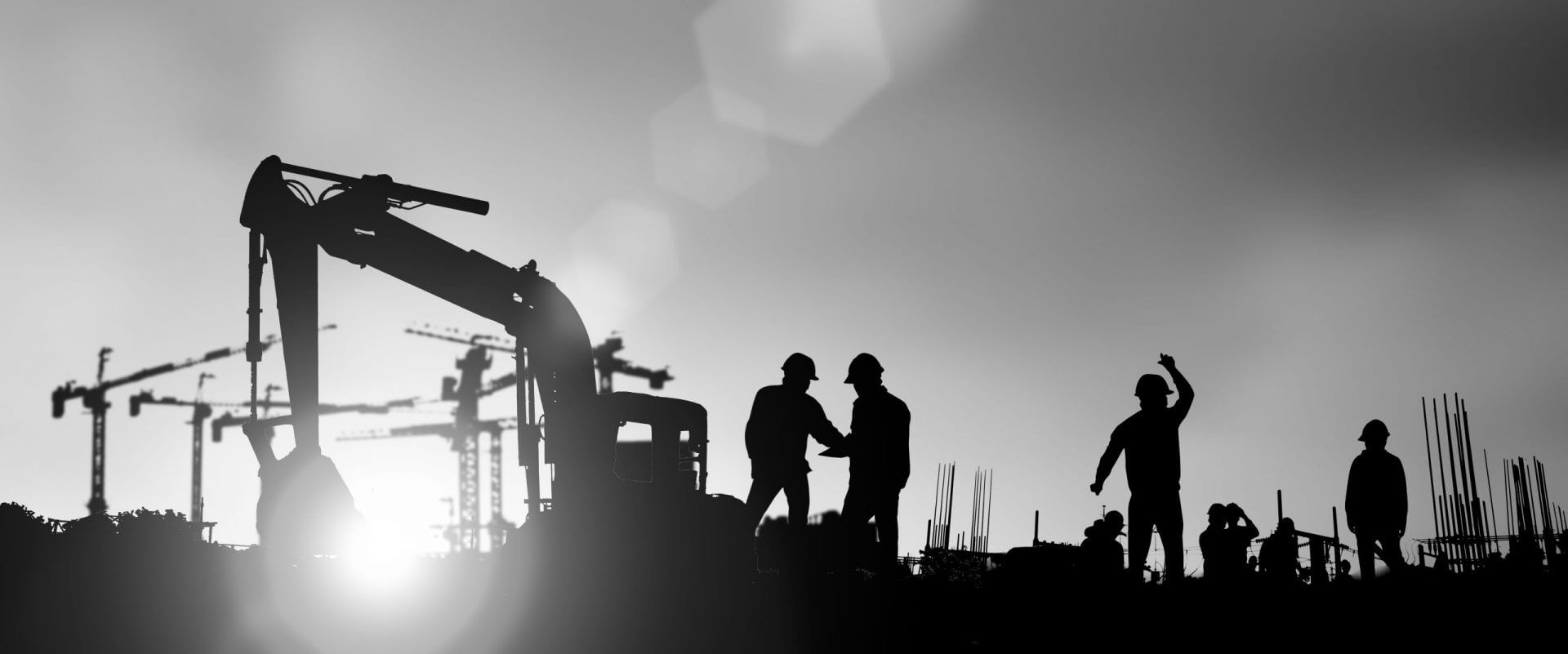 Silhouette of engineer and construction team working at siteloading=