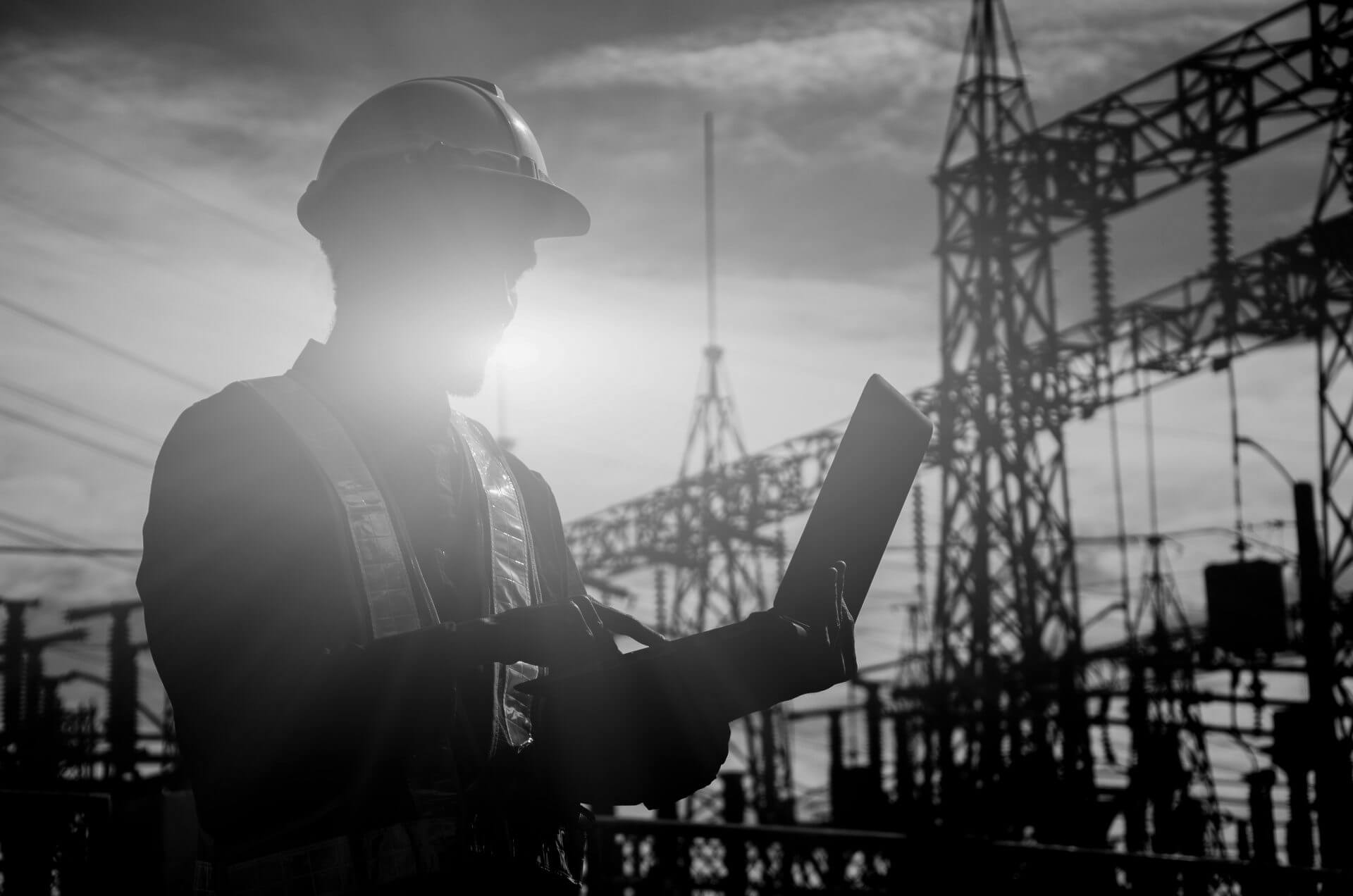 Silhouette of working engineer in the construction site.loading=