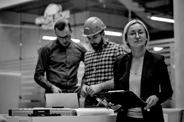 portrait of leading female architectural engineer artist working with colleagues